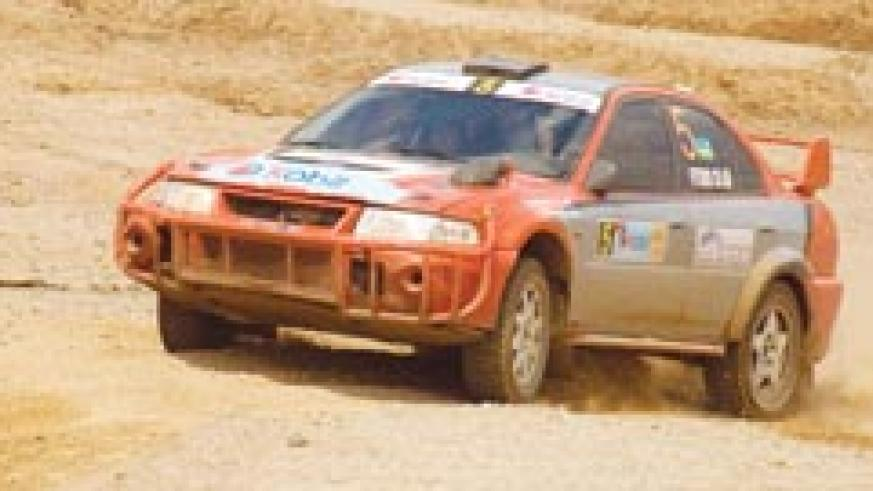 Fitidis powers his machine during the 2007 Irushanwa rally. The ace driver finished fourth in yesterday's Super Special Stage. The New Times/File.