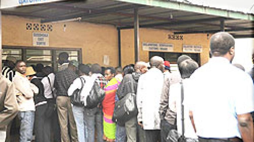 Travellers queue at Gatuna Immigration offices for clearance. The New Times / File photo