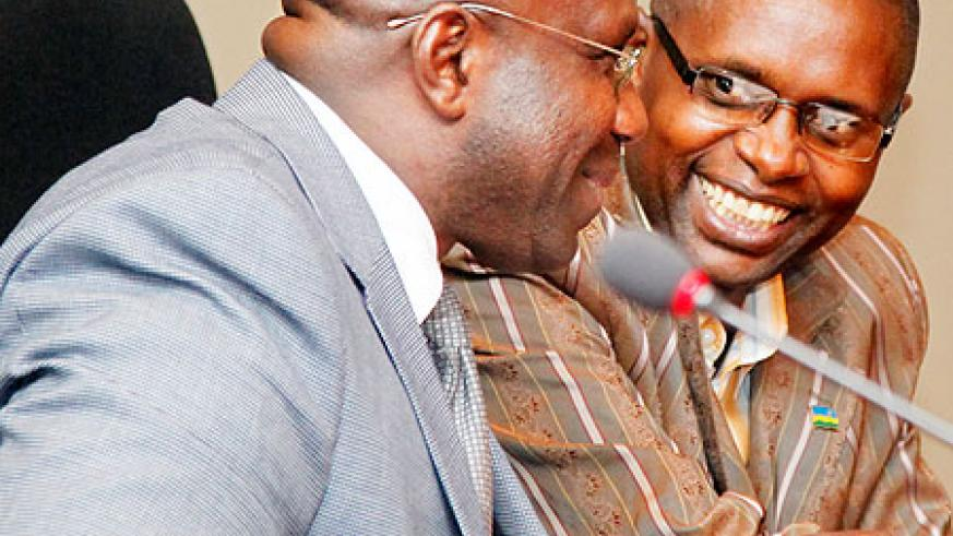 The Minister of Education, Damien Habumuremyi (L) together with State Minister Dr Mathias Harebamungu during the town hall meeting, yesterday, where the use of ICT in schools was discussed. The New Times/Timothy Kisambira.