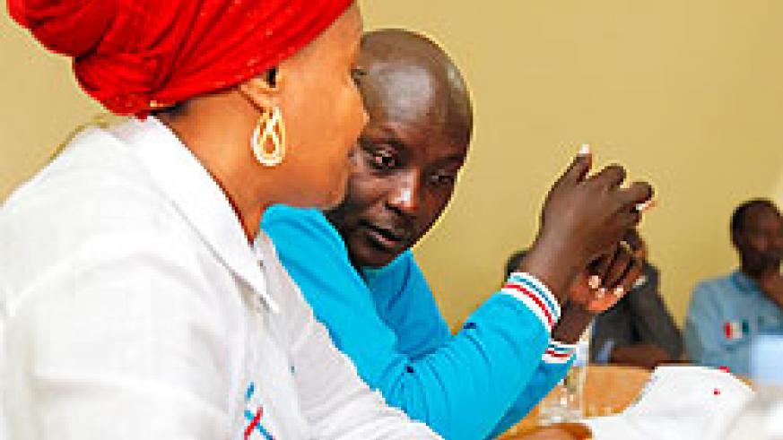 (R-L) Paul Jules Ndamage, the RPF district chairperson chats with Zulfat Mukarubega the vice chairperson of the party during the meeting, yesterday. The New Times Timothy Kisambira