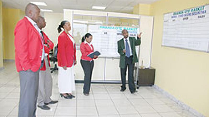 Traders at the Rwandan bourse / The New Times\ File photo