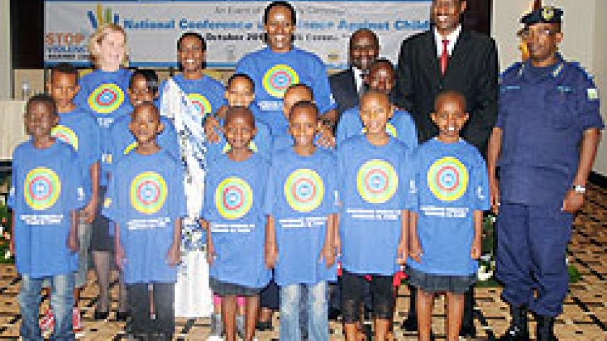 Pictured with Children during the National Conference on Violence against Children yesterday are; (L-R) UNICEF Representative Noala Skinner, Minister Aloysia Inyumba of Gender and Family Promotion, First Lady Jeannette Kagame, and Ministers Pierre Damien