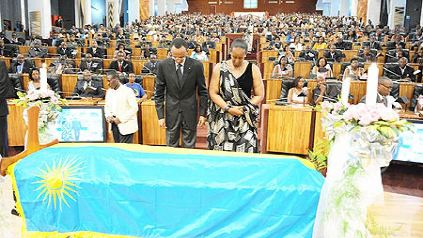 President Kagame and First Lady, Jeannette Kagame pay their respects to the late minister Nyatanyi at Parliament buildings yesterday. The New Times \Village Urugwiro.