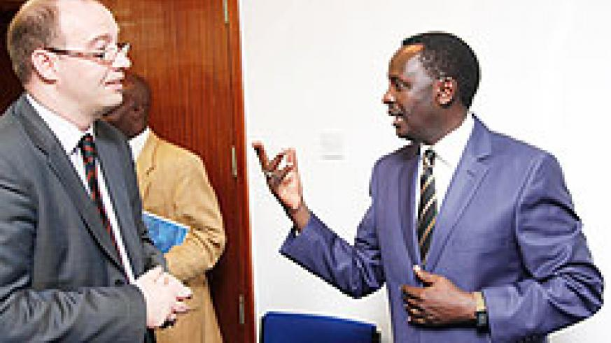 Martin Ngoga, the Prosecutor General (R) chats with Ben Llewellyn-Jones, the British High Commissioner at the beginning of the training of investigators. The New Times Timothy Kisambira