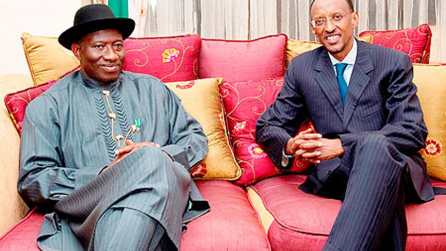 President Kagame and his Nigerian counterpart, President Goodluck Jonathan, shortly after the latter's arrival at Kigali International Airport, yesterday. The New Times \Village Urugwiro.