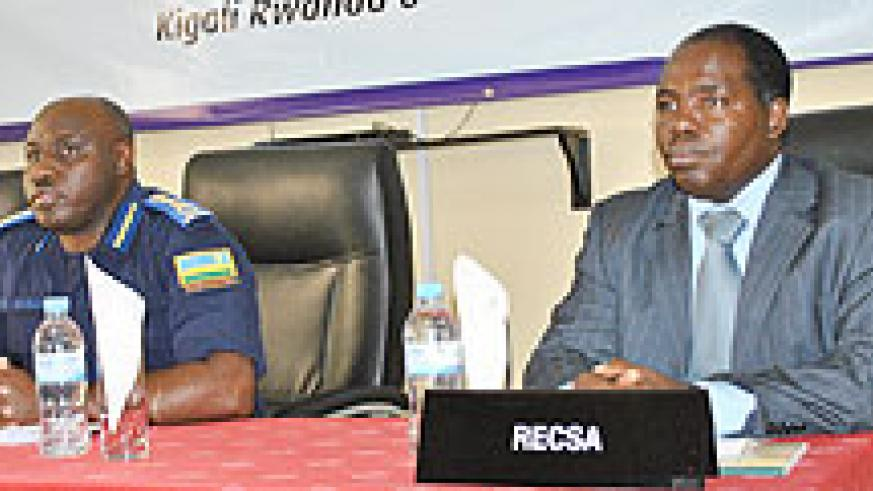 IGP Emmanuel Gasana and Francis Wairagu of RECSA during the AFCON meeting yesterday. The New Times \Timothy Kisambira.