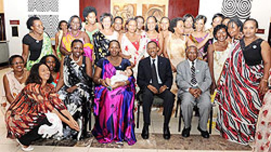 President Kagame and First Lady Jeannette Kagame, Bishop (Rtd) John Rucyahana (R-seated) with members of the Diaspora at the Gala yesterday. The New Times/Village Urugwiro.