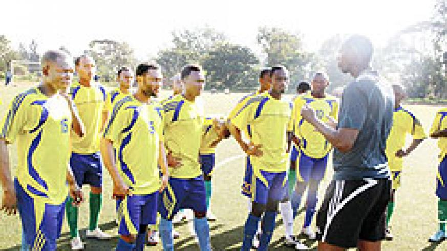 Amavubi interim coach Nshimiyimana passing on tips to his players in one of the team's training sessions. He wants to make the job his own. The New Times/File photo