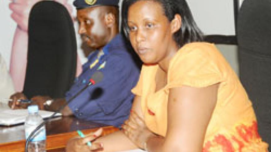 Chief Gender Monitor Oda Gasinzigwa (L) and ACP Vianney Nshimiyimana at the meeting yesterday. The New Times / J Mbanda