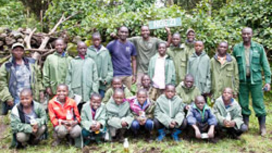 Pupils from primary schools within the Virunga area pose for a group photo with park guides during their tour of the park recently. The NewTimes / B Mukombozi