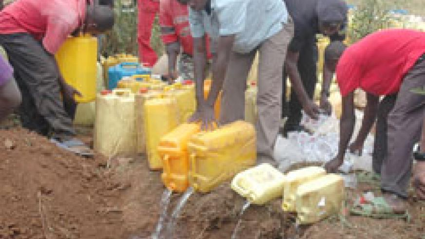 Hundreds of litres of Illicit brew was destroyed. The New Times / Courtesy.