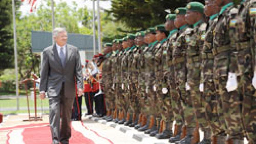 The US Envoy to Rwanda, Donald W. Koran, who was first to present credentials inspects a guard of honor at Village Urugwiro, yesterday. The New Times / Village Urugwiro.