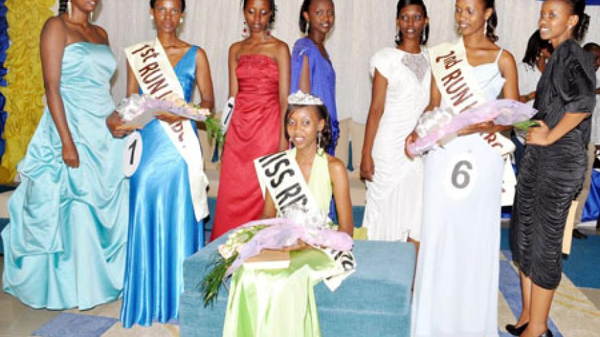All Smiles! Miss KHI Sandra Kayitesi poses for a photo session with other contestants. The New Times / Courtesy.