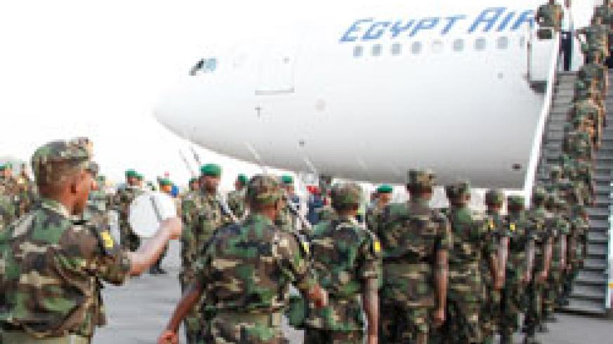 RDF Soldiers leave Kigali for a peacekeeping mission. Two peacekeepers have died in an ambush in troubled region of Darfur.The New Times / File.