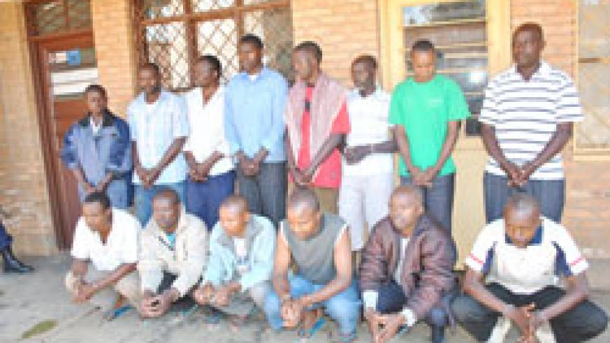 The suspects under police custody. The New Times / Courtesy.