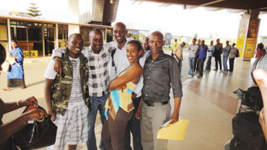 Tom Close (L) poses with friends at Kigali International Airport. The New Times/Courtesy.