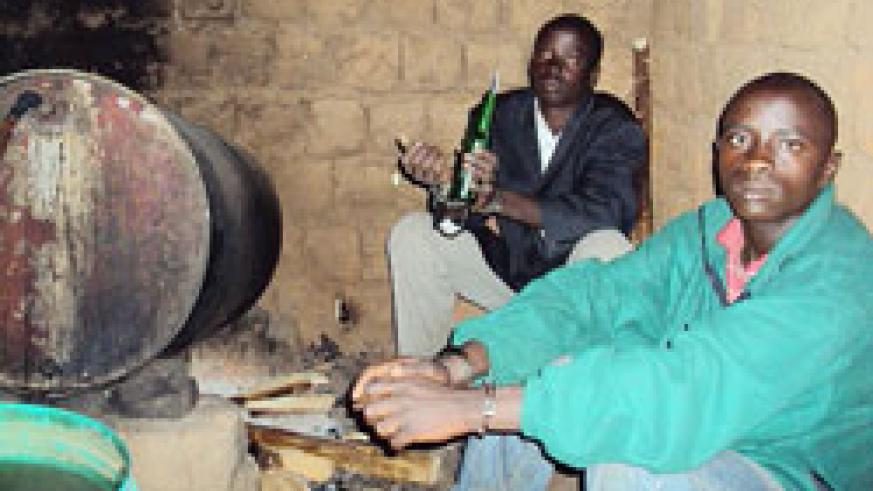 Suspects at their brewing joint in Mbare, Shyogwe. The New Times / D.Sabiiti