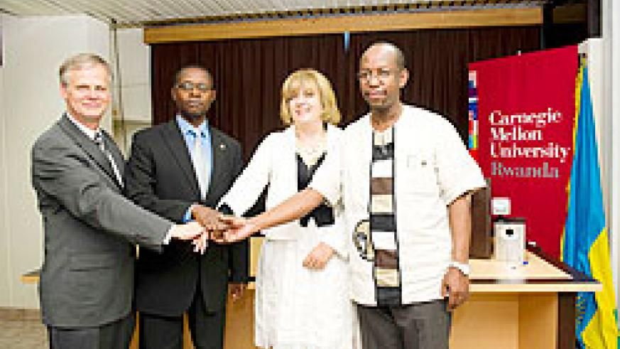 Bruce Krogh, Director, CMU Rwanda, State Minister Dr Mathias Harebamungu, AfDB's  Dr. Agnes Soucat and John Gara of RDB after announcing the partnership The New Times Courtesy