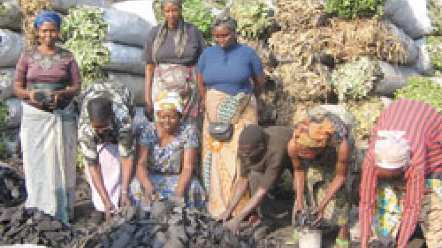 Female charcoal dealers at work. They would soon benefit from and exclusive women's bank to easily access loans to expand their businesses.The NewTimes / File