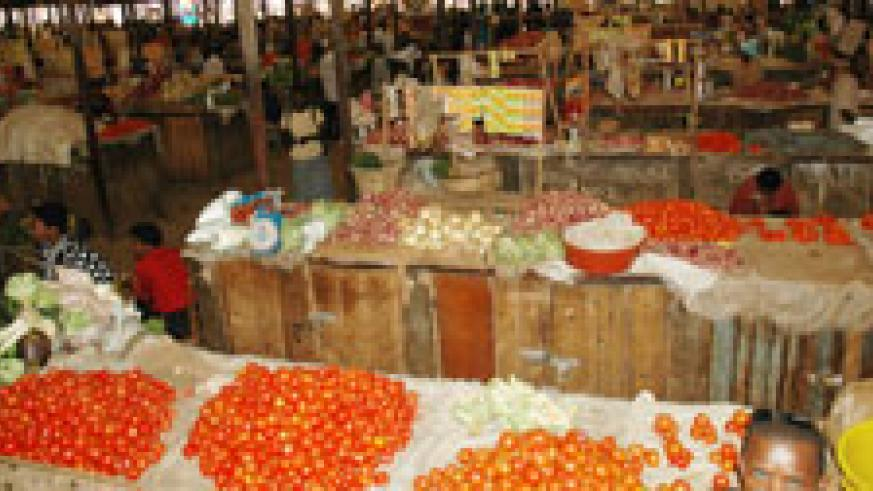 Foodstuff stalls in Kimironko Market. Premier Habumuremyi has called for commercialised farming in Musanze. The New Times / File