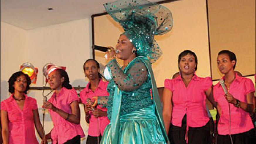 Lillian Kabaganza (C) performing at the launch of her album, backed up by Gates of Heaven choir./ Courtesy photo.