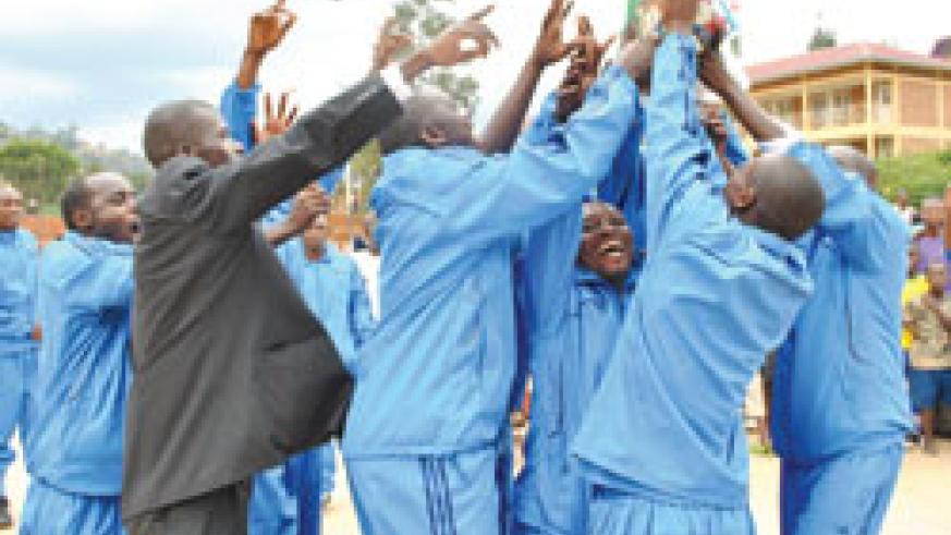 Police players celebrate after being crowned 2011 national handball league champions over the weekend. The New Times / B. Mugabe