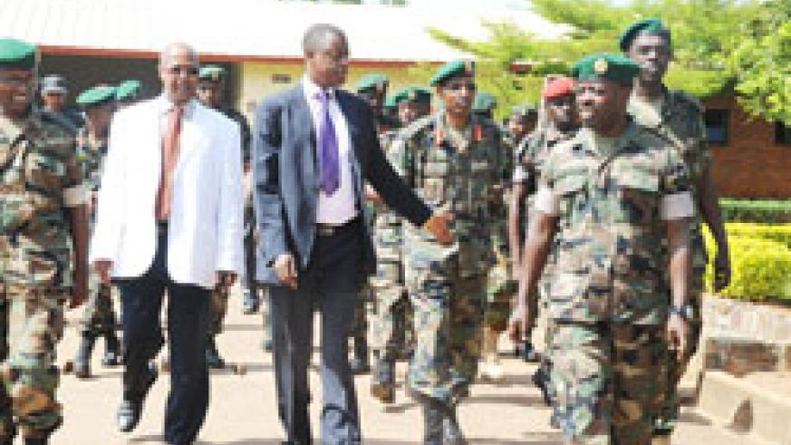 Military Hospital Director Dr Ben Karenzi (L) shows Defence Minister James Kabarebe and other officers around the facility earlier this year. The New Times / File.