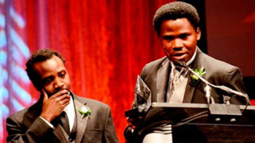 Rwandan actor Edourd Bamporiki speaks at the gala night of Heartland Film Festival in Indianapolis, USA. Looking on is Alrick Brown, the Director and Writer of the Kinyarwanda . Net photo