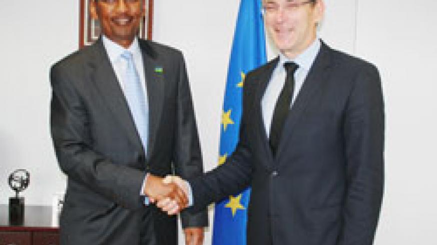 Andris Piebalgs (R), the European Commissioner in charge of development, receives Rwanda's Finance Minister, John Rwangombwa, in Brussels this week.The New Times / File.