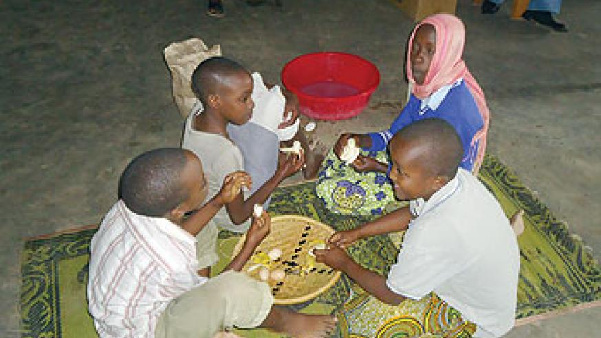 Children act in play about healthy nutrition in Nyanza district, Southern province.