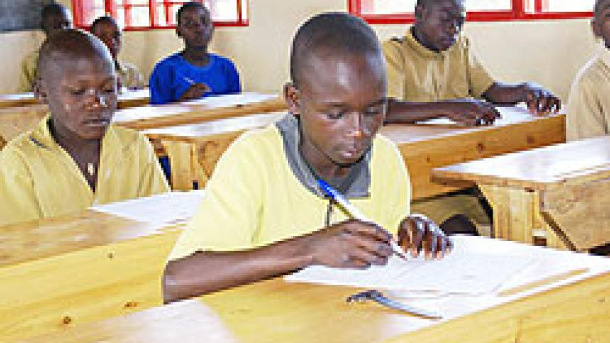 Pupils write their PLE exam. This year's examinations kick off today. The New Times / File photo
