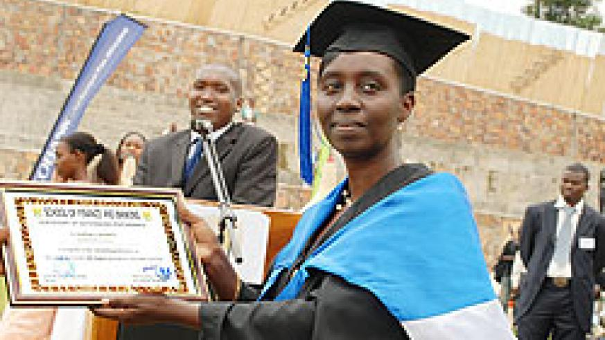 An SFB graduate displays a certificate of outstanding performance. Students at the school have said the new system remains a stumbling block. The New Times/File photo.