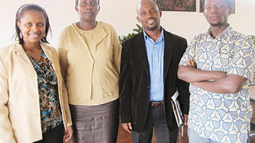 Pastor Florence Mugisha (L) poses for a group photo with other members of New Life Bible Church shortly after the press