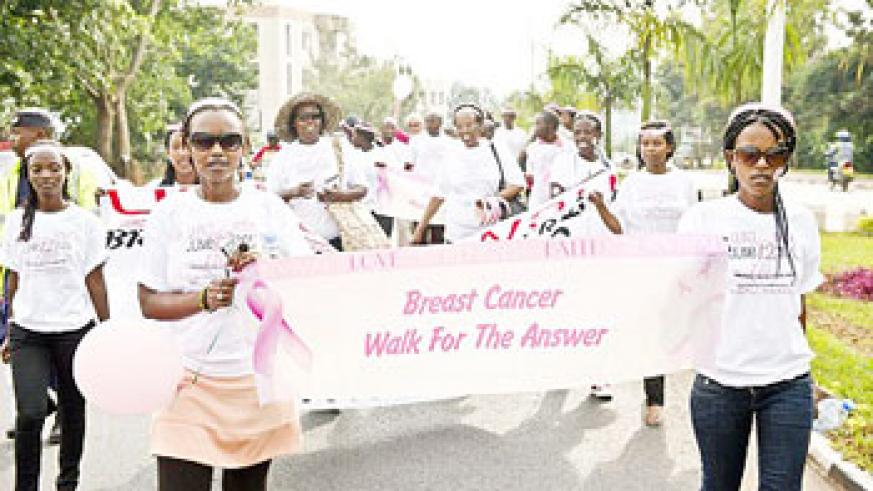 Young Rwandan women walk during the program aimed at supporting breast cancer  awareness. (Net Photo.)