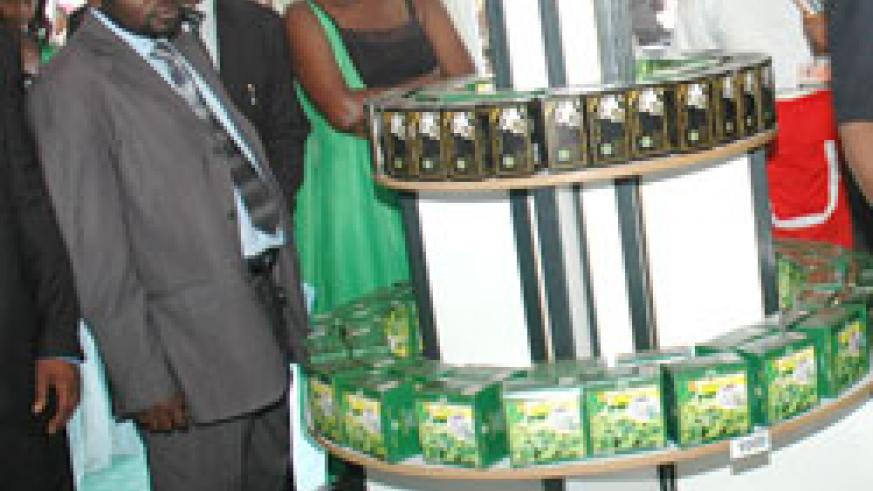 People admire Rwandan tea during a past trade show. Local producers have termed the regional business competition 'biting'. The New Times / File.