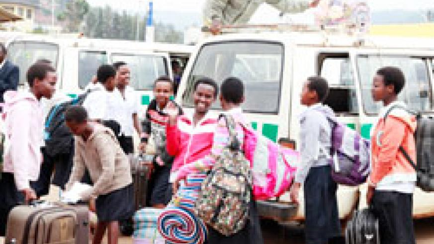 Students coming back from school yesterday. They have welcomed the new initiative of going back home in shifts. The New Times / Timothy Kisambira