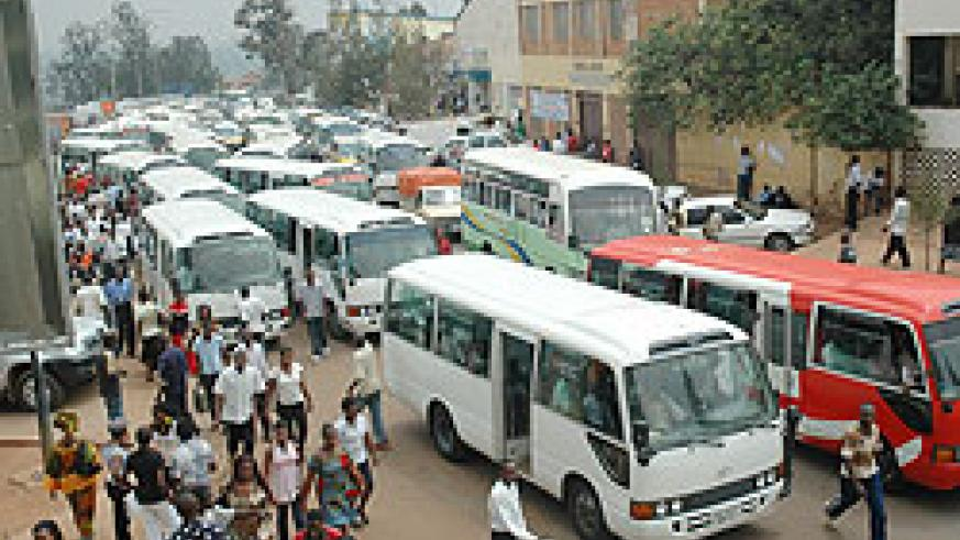 Traffic snarl up  in Kigali's Central Business District. Minibuses will gradually be phased out from the city.