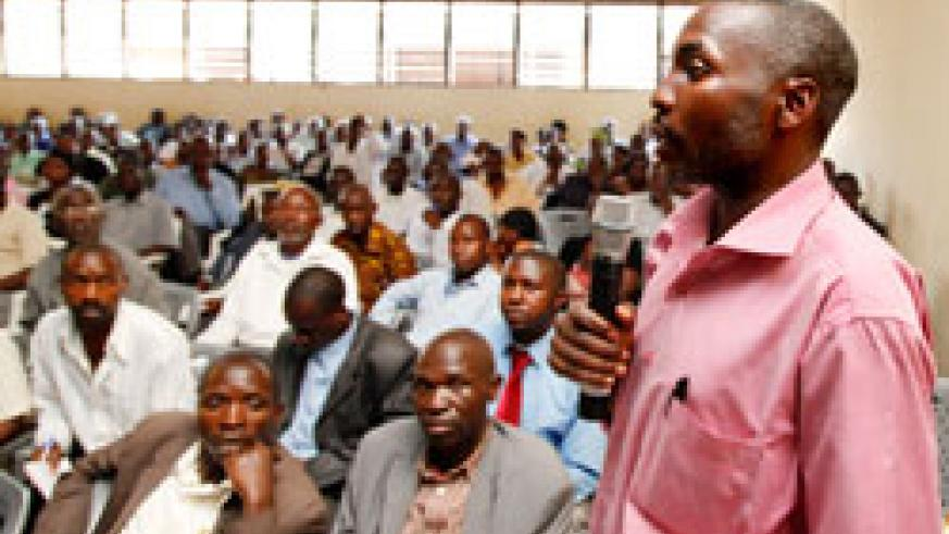 Theogene Batumika, Inspector of Education, Bwira Sector in Ngororero District, speaking during the cooperative's general assembly. The New Times / T. Kisambira.