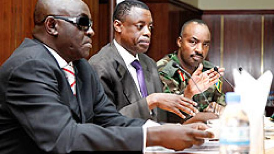 (L-R)James Ndahiro, Defence Minister Gen. James Kabarebe  and CDS Lt Gen. Charles Kayonga at the CSS annual meeting yesterday. The New Times/  Timothy Kisambira.
