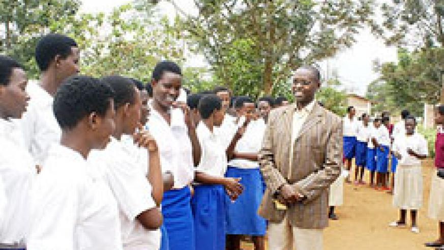 State Minister Mathias Harebamungu with students before commissioning of O Level Exams last year. Students have said they are ready for the examinations tomorrow. The New Times/ File.