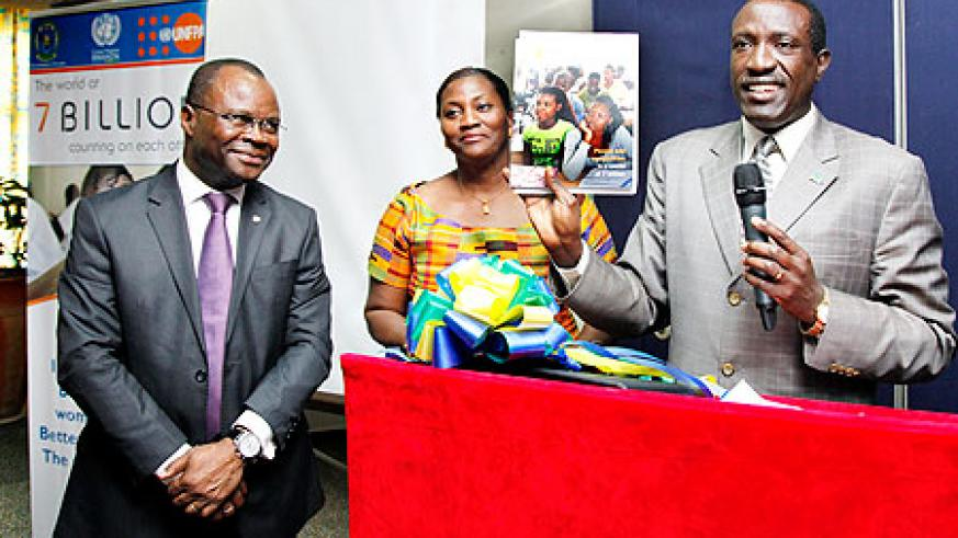 (L-R) UN Resident Coordinator Aurelien Agbenonci, Victoria Akyeampong, the UNFPA Representative, and Senate President, Dr. Jean Damascene Ntawukuriryayo, during the launch of the World Population Report 2011, in Kigali, yesterday. The New Times/ Kisambira