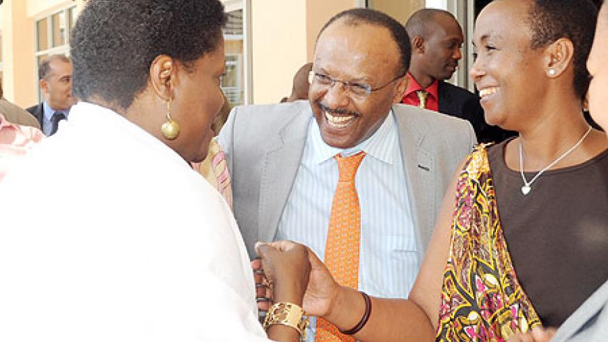 Minister Aloisea Inyumba (R) and UN Assistant Secretary General Tegegnework Gettu (C) talking to Thokozile Ruzvidzo, a participant at the 8th AGF in Kigali yesterday. The New Times / John Mbanda.