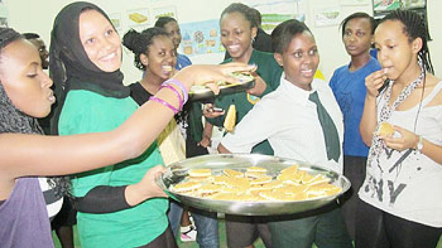The Cooking Club team makes tasty snacks for sale to help the needy. Photo P. Mbabazi.