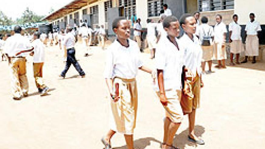 O Level candidates walk out of the examination room after the first session. The New Times/John Mbanda.