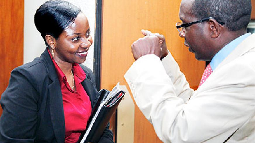 Emma Francoise Isumbingabo, State Minister for Energy (L), talking to Evariste Kalisa, Deputy Speaker of Parliament Yesterday after the session. The New Times / Timothy Kisambira.