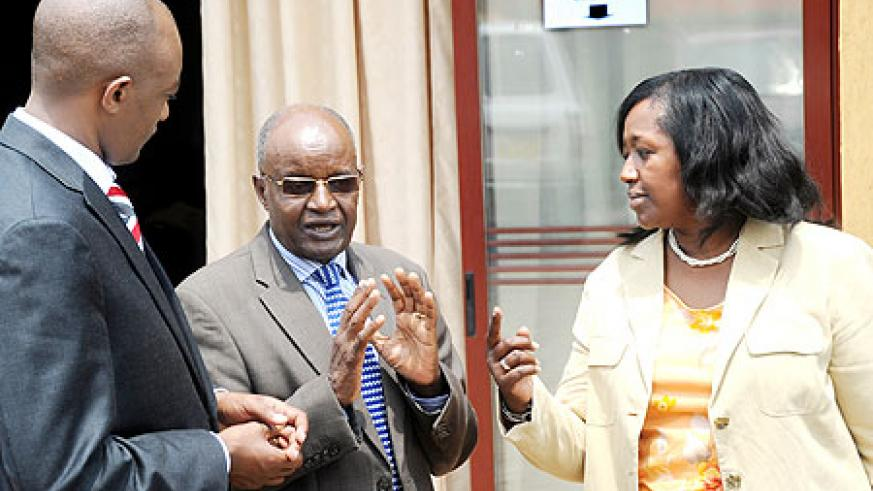 The Minister of Health, Dr Agnes Binagwaho (R) talks to the RMC president Dr. Innocent Gakwaya (C) and Dr. Stephen Rulisa, RMA president after opening the RMC meeting yesterday.The New Times / J. Mbanda