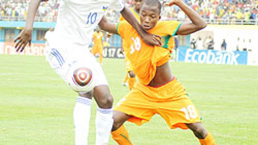 Proline Academy striker Andrew Buteera shields the ball from an Ivory Coast player in the Caf U-17 Championship early this year. He is one of six professionals summoned to the Amavubi squad. The New Times / File