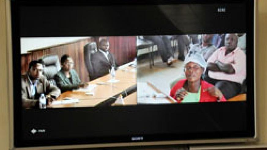 A plantiff from Rusizi District (R) talks to Supreme Court President Aloysie Cyanzayire and other judges in Kigali through video link yesterday. The New Times / John Mbanda.