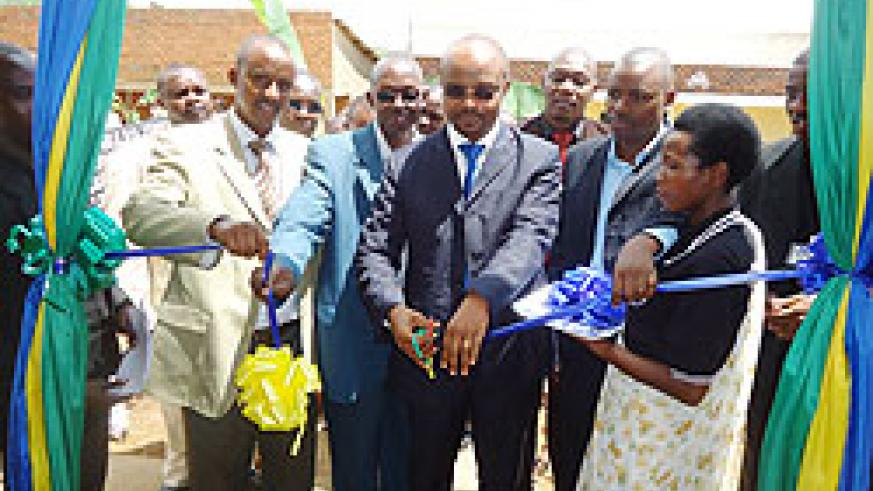 Infrastructure Ministry's Jean de Dieu Hakizimana (C) with Mayor Bernard Kayumba (L) and other local leaders at the launch of SACCO in Karongi. The New Times ./ S Nkurunziza.