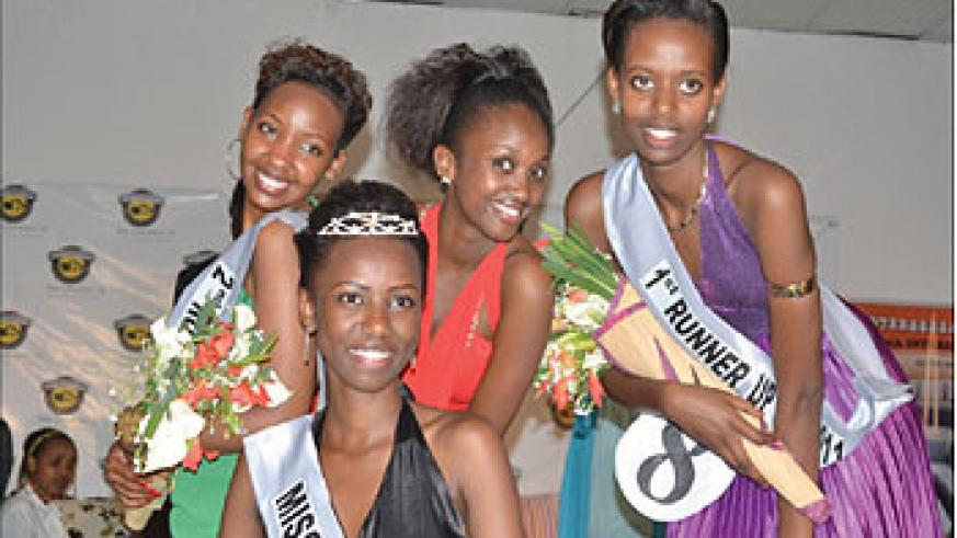 All smiles! The winner of Miss SFB 2011 Natacha Uwamahoro (clad in a black dress) poses for a photo, with 1st Runner-up Carmen Akineza (R), Miss Popularity Rachel Umukunzi (C) and 2nd Runner-up San